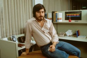 """Steve Jobs. Note the """"THINK"""" poster in the background. My uncle printed that one, too."""